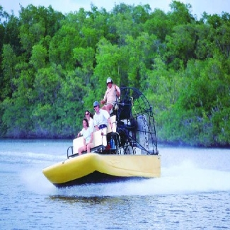 Man_Driving_Tourists_On_His_Airboat_in_the_Everglades